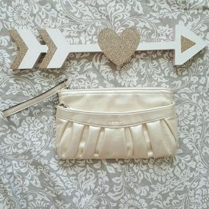 Elle cream color wristlet with many pockets
